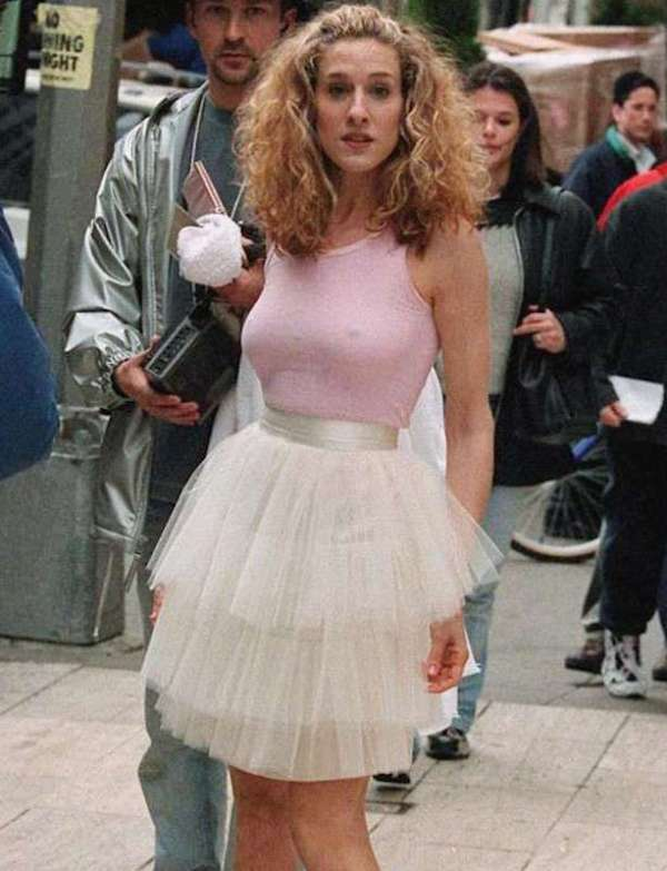 Scene from the opening Sex and the City theme song showing lead character Carrie Bradshaw, played by Sarah Jessica Parker, stylishly navigating the bustling streets of New York City in a whimsical pink tulle tutu