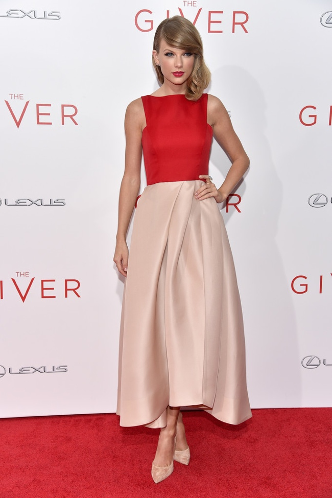 Taylor Swift wearing a red-blush color-block Lhuillier gown in 2014