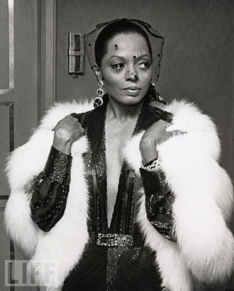 Diana ross in a white fur and plunging neckline makes a timeless fashion statement
