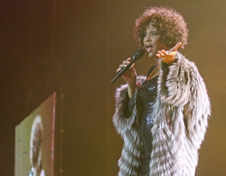 Even while performing fur was the choice fabric for Whitney