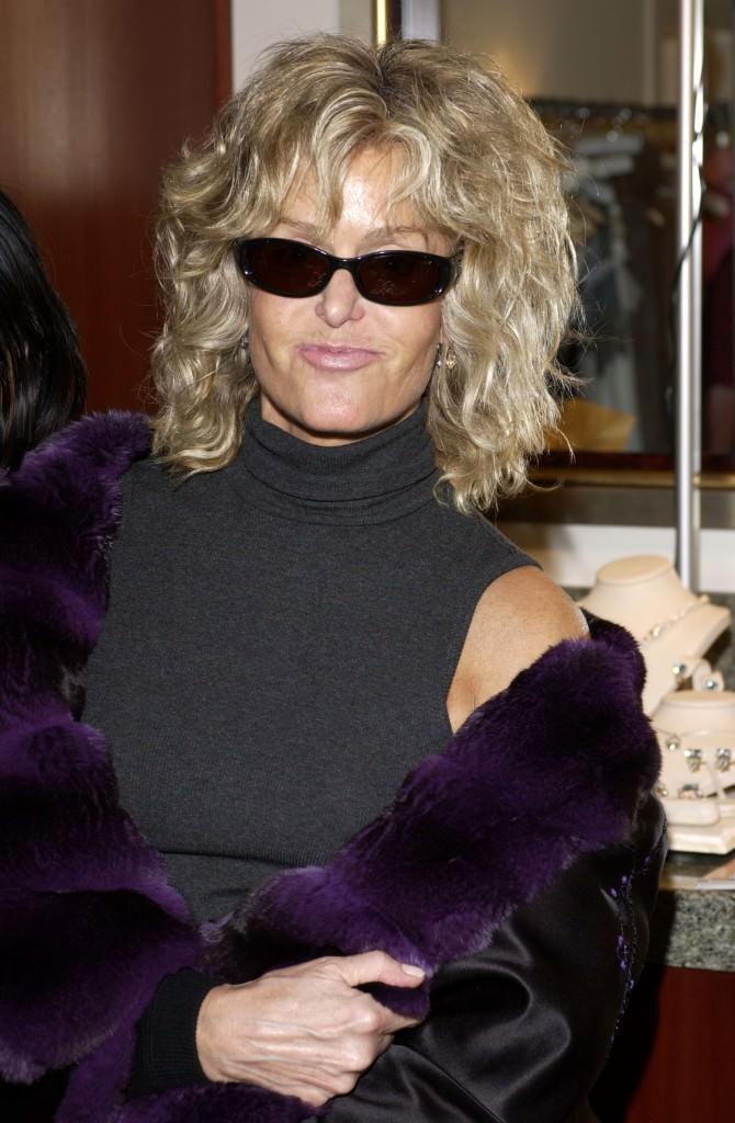 Farrah in a coat trimmed in luxurious deep purple fur