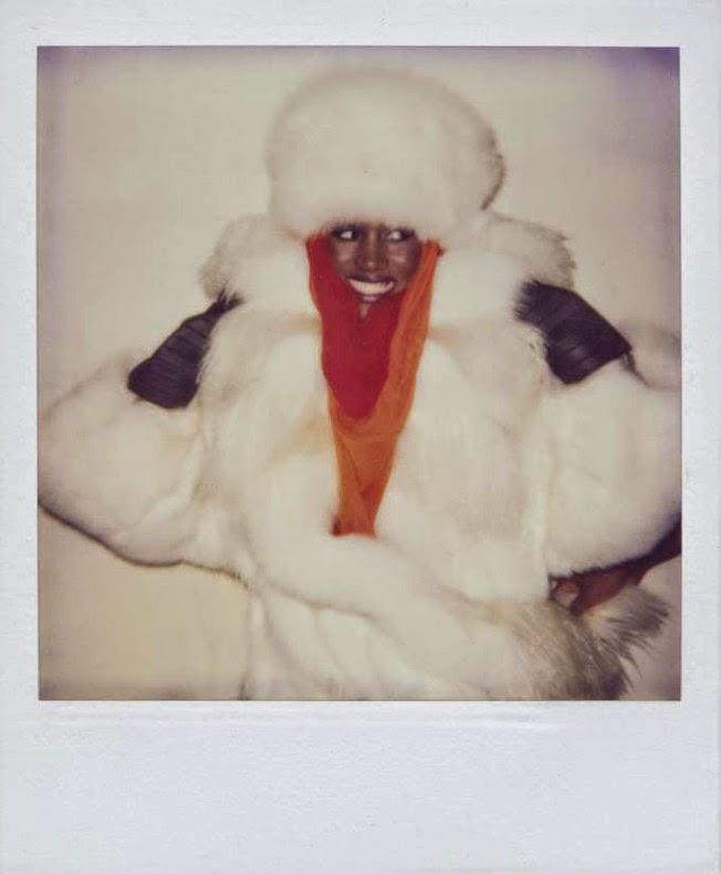Grace Jones draped in fur. Polaroid by Andy Warhol