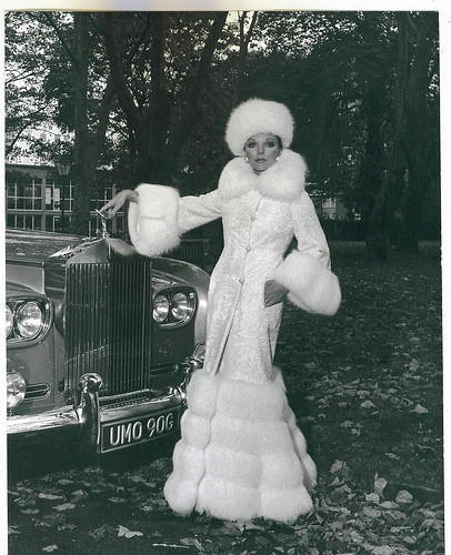 Joan Collins poses in white fox from head to toe -she is truly regal