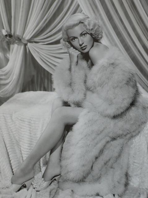 Lana Turner draped in fur from head to toe