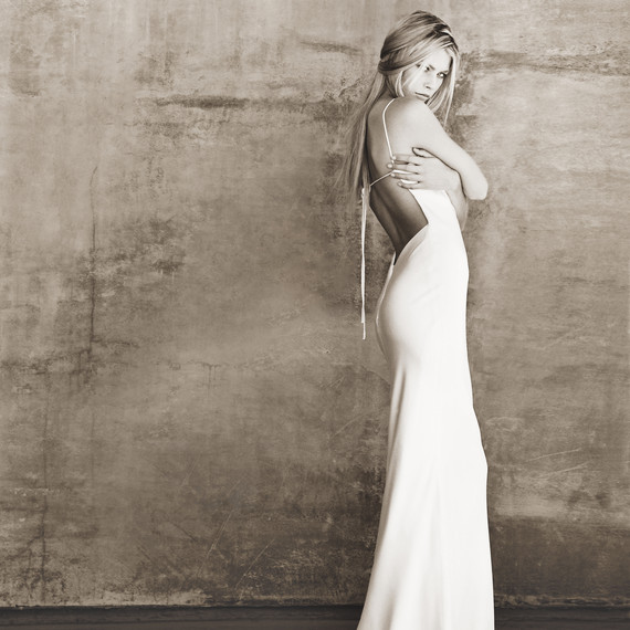 """The very first wedding dress design Monique Lhuillier created the """"Laura"""". The dress was simple, stylish, understated and elegant; a big departure from everything else available on the marketplace in the late 1990s"""