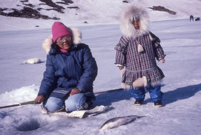 Alaska Native mother and child in traditional parkas in Alaska