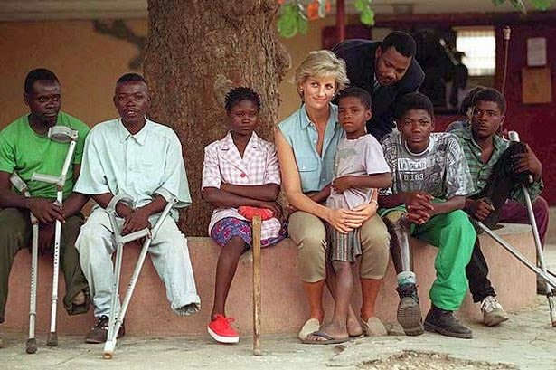 """Prince Harry's mother Princess Diana was affectionoately known as """"The People's Princess"""". Here she is seen visiting victims of land mines in Angola Africa"""