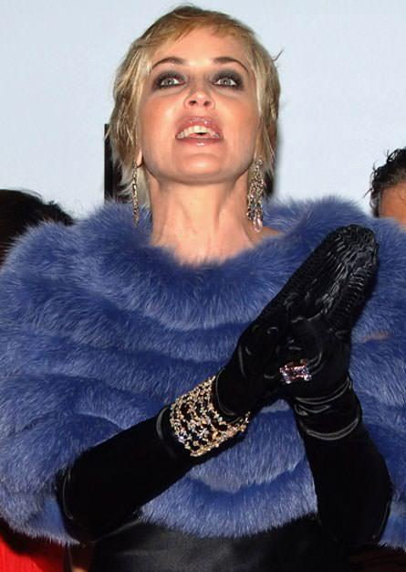Sharon Stone in a bold purple fur